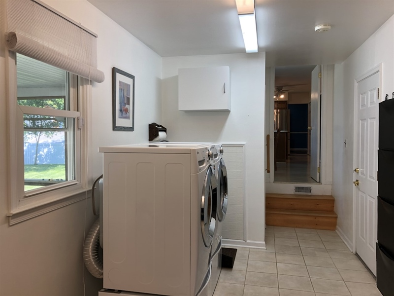 Real Estate Photography - 702 W Church Rd, Newark, DE, 19711 - Newer Washer/Dryer & window to back porch