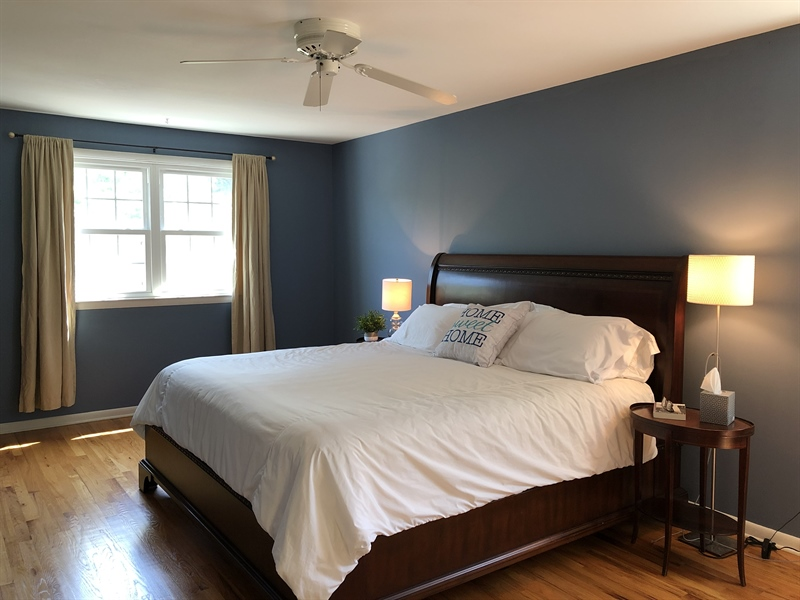 Real Estate Photography - 702 W Church Rd, Newark, DE, 19711 - Spacious Master Bedroom w/ hardwoods & ceiling fan