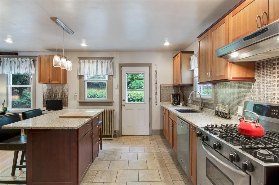 Real Estate Photography - 203 Grandview Ave, Wilmington, DE, 19809 - Kitchen w/ 5 burner gas stove & backyard door.