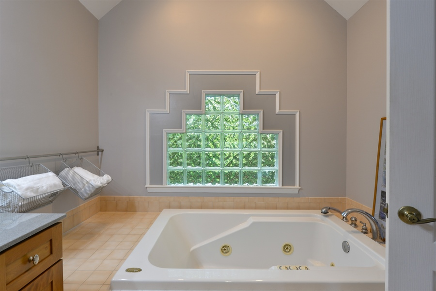 Real Estate Photography - 1155 Shady Beach Rd, Elkton, MD, 21921 - Jacuzzi 2 person tub, glass block window