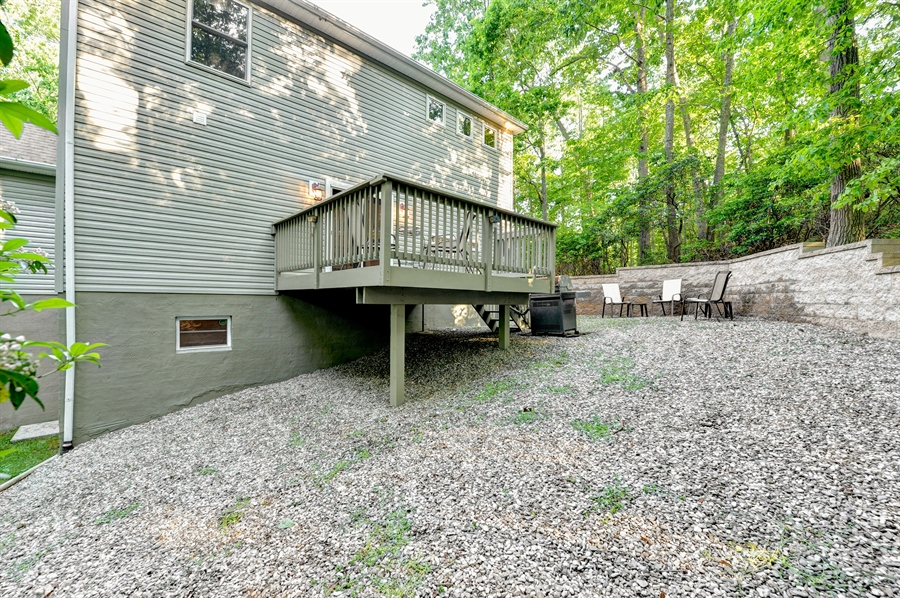 Real Estate Photography - 1155 Shady Beach Rd, Elkton, MD, 21921 - River rock stone patio