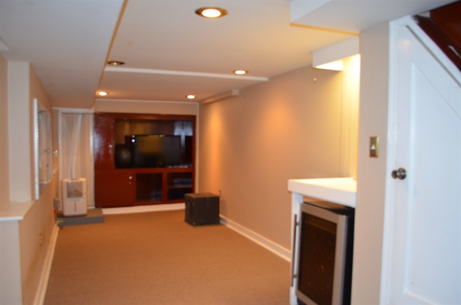 Real Estate Photography - 907 S Broom St, Wilmington, DE, 19805 - Finished Basement w Walk-out to backyard