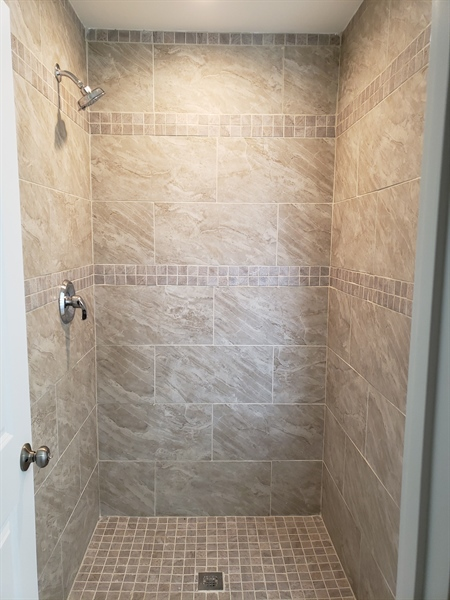 Real Estate Photography - 81 Goshawk Ln, Camden Wyoming, DE, 19934 - Tiled walk-in shower