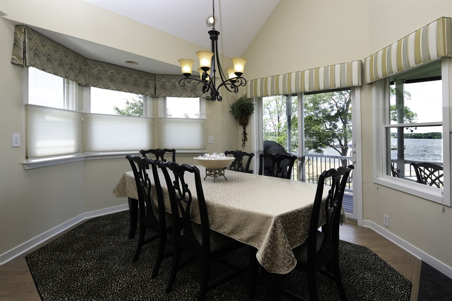Real Estate Photography - 64 Shipwatch Ln, Chesapeake City, MD, 21915 - DINING AREA WITH FIREPLACE AND WATERVIEWS!!