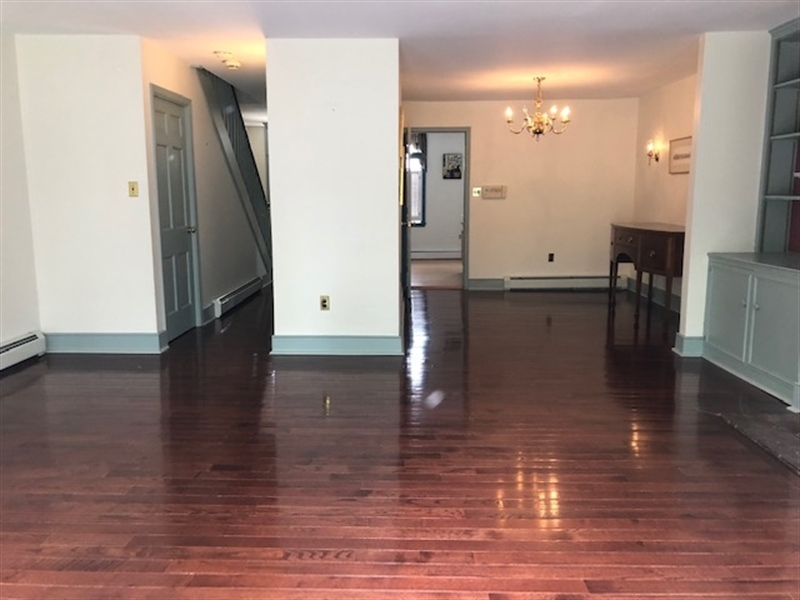 Real Estate Photography - 41 E 4th St, New Castle, DE, 19720 - Living Room with Gleaming Hardwood Floors