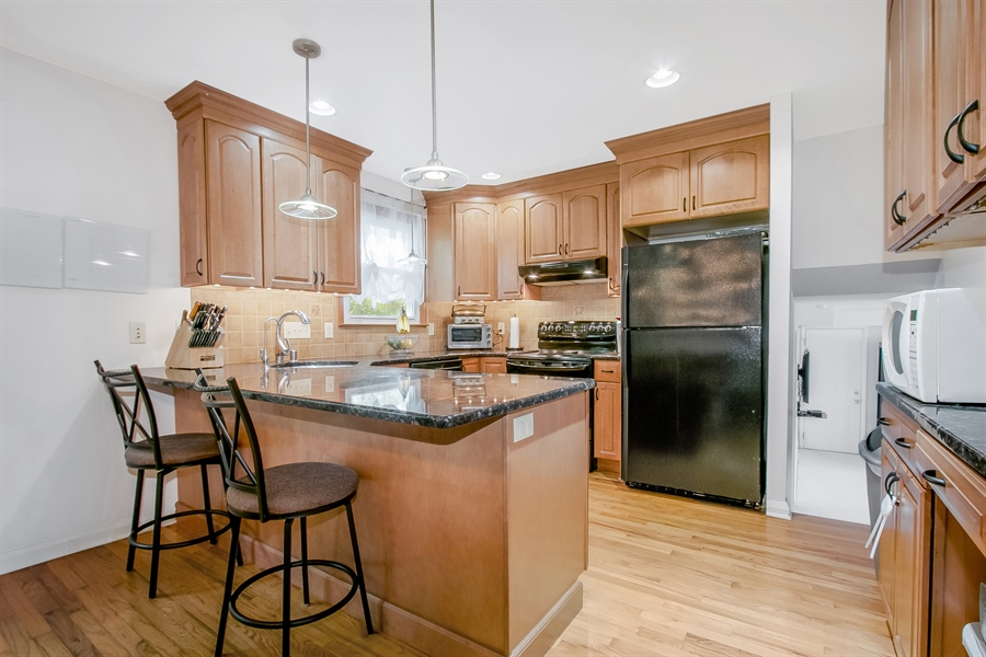 Real Estate Photography - 2040 Floral Dr, Wilmington, DE, 19810 - Updated Kitchen with Breakfast Bar