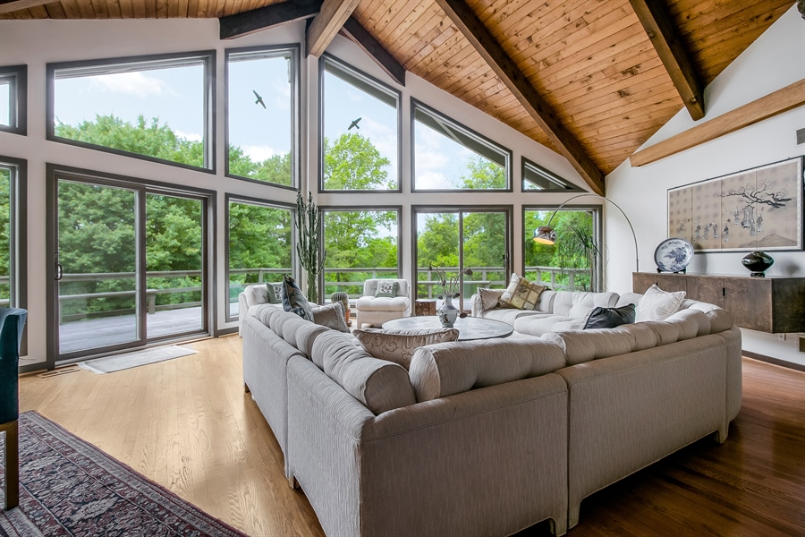 Real Estate Photography - 108 1/2 S Spring Valley Rd, Wilmington, DE, 19807 - Dramatic Living Room with vaulted ceiling & views