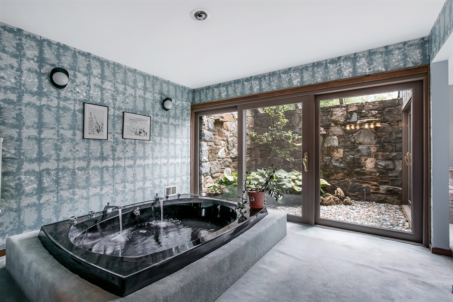 Real Estate Photography - 108 1/2 S Spring Valley Rd, Wilmington, DE, 19807 - Soaking Tub with views of Atrium