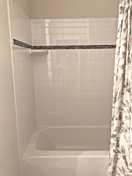 Real Estate Photography - 21414 Catalina Circle #C-12, C-12, Rehoboth  Beach, DE, 19971 - Tiled Shower Surround Hall Bath