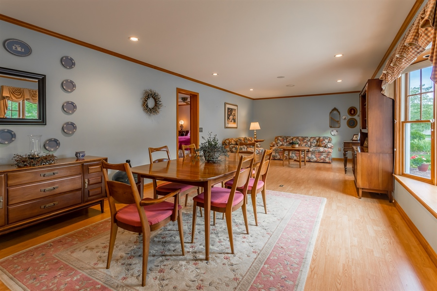 Real Estate Photography - 23125 Lakeview Dr, Millsboro, DE, 19966 - Dining Room and Living Room - Front side