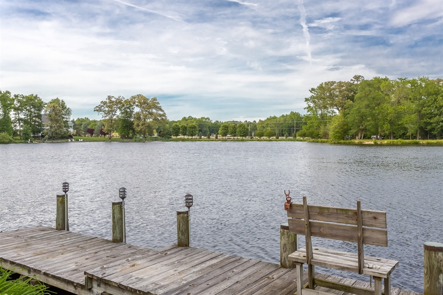 Real Estate Photography - 23125 Lakeview Dr, Millsboro, DE, 19966 - Plenty of fish to be caught in the pond.
