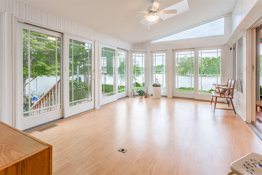 Real Estate Photography - 23125 Lakeview Dr, Millsboro, DE, 19966 - Sunroom overlooking the garden and lake