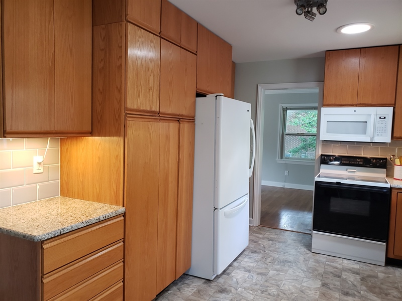 Real Estate Photography - 228 Beverly Rd, Newark, DE, 19711 - Pantry Next to Refrigerator