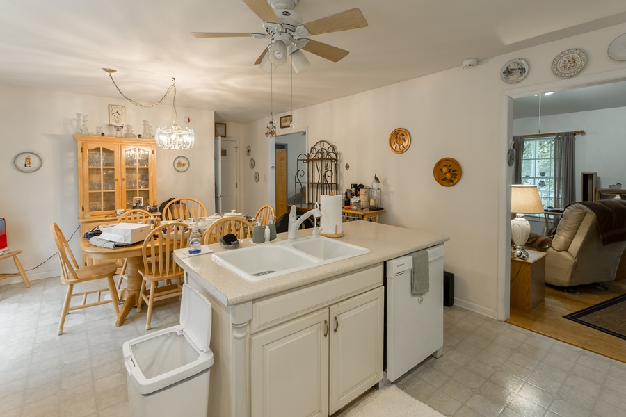 Real Estate Photography - 320 Clearbrooke Blvd, Seaford, DE, 19973 - KITCHEN ISLAND AND DINING ROOM