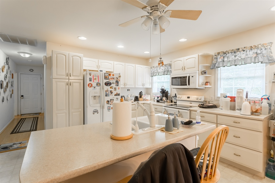Real Estate Photography - 320 Clearbrooke Blvd, Seaford, DE, 19973 - KITCHEN WITH ISLAND AND BREAKFAST BAR