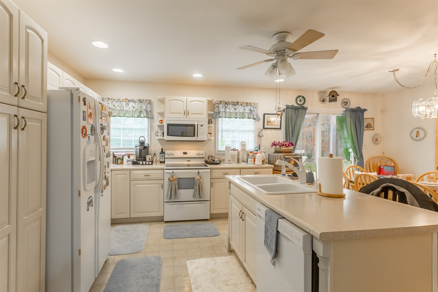 Real Estate Photography - 320 Clearbrooke Blvd, Seaford, DE, 19973 - KITCHEN WITH ISLAND WITH BREAKFAST BAR
