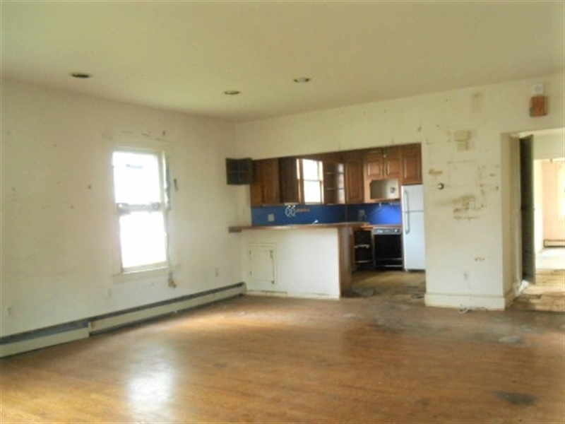 Real Estate Photography - 403 W 29th St, Wilmington, DE, 19802 - Living Room into Kitchen View