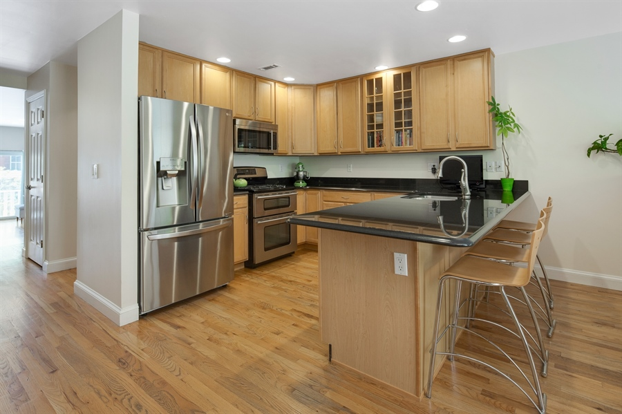 Real Estate Photography - 1411 N Franklin St, Wilmington, DE, 19806 - Kitchen featuring granite and double oven