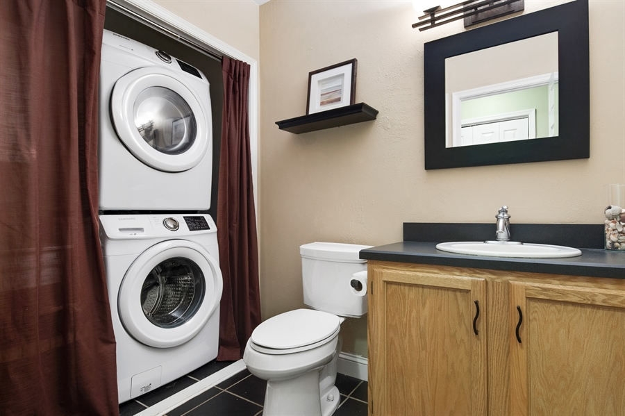 Real Estate Photography - 1411 N Franklin St, Wilmington, DE, 19806 - Laundry in half bath in basement