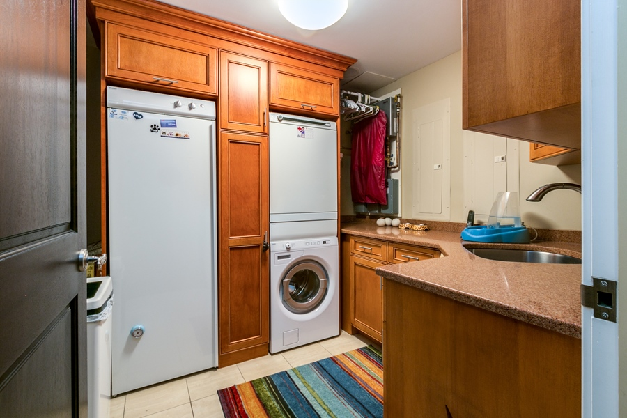 Real Estate Photography - 1702 N Park Drive #18, 18, Wilmington, DE, 19806 - Laundry Room with Drying Cabinet