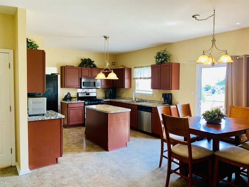 Real Estate Photography - 138 Cornwell Dr, Bear, DE, 19701 - Eat-in Kitchen with access to rear deck & backyard