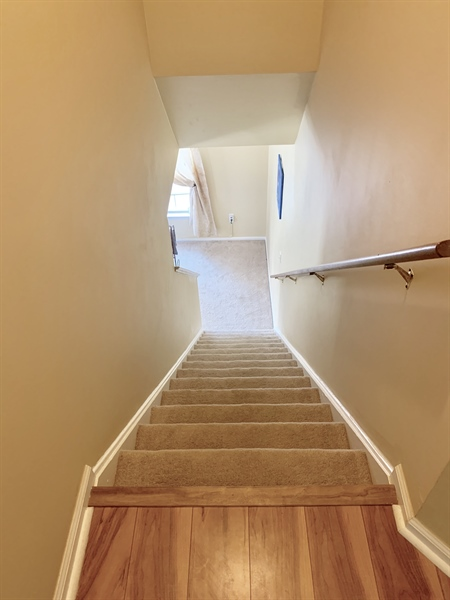 Real Estate Photography - 138 Cornwell Dr, Bear, DE, 19701 - Rear Staircase from Family Room to 2nd Floor