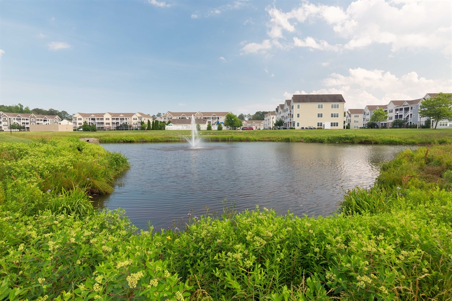 Real Estate Photography - 19350 Mersey Drive #D2, D2, Rehoboth  Beach, DE, 19971 - Pond/Fountain View from Deck