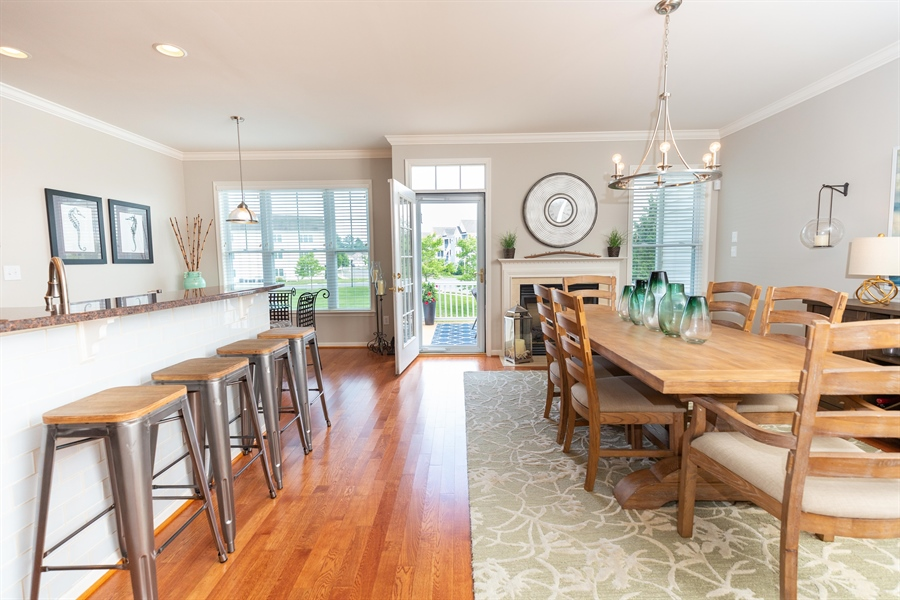 Real Estate Photography - 19350 Mersey Drive #D2, D2, Rehoboth  Beach, DE, 19971 - Island w/ Bar Seating and Dining Room