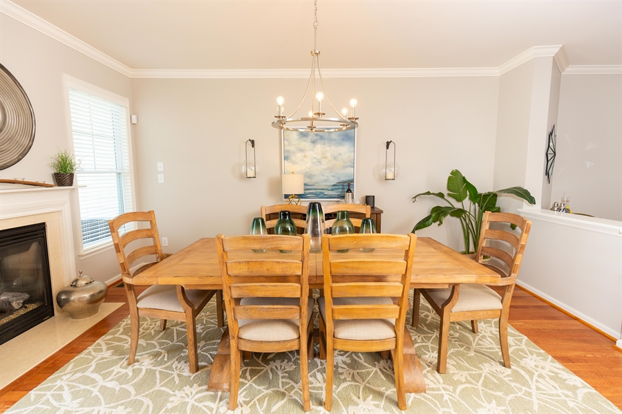 Real Estate Photography - 19350 Mersey Drive #D2, D2, Rehoboth  Beach, DE, 19971 - Dining Room w Gas Fireplace