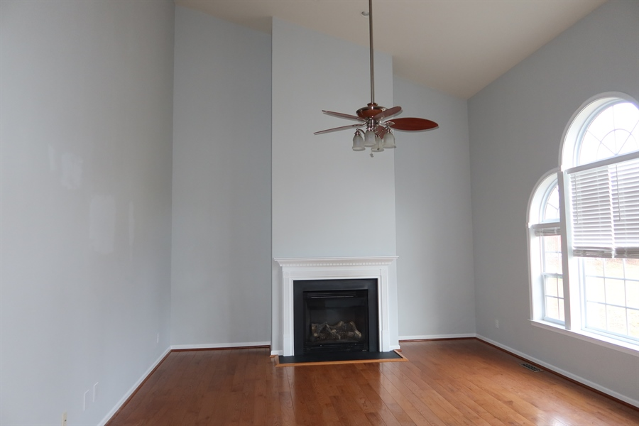 Real Estate Photography - 90 Mccormick Way, Lincoln Univeristy, DE, 19352-9052 - Family Room with Hardwood Floors and Gas Fireplace
