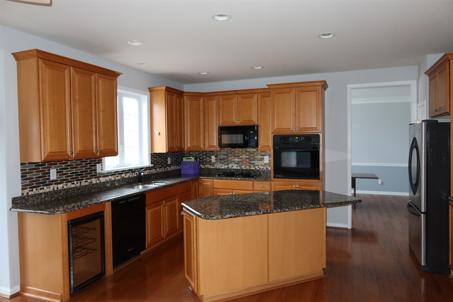Real Estate Photography - 90 Mccormick Way, Lincoln Univeristy, DE, 19352-9052 - Eat-In Kitchen with Hardwood Floors & Island