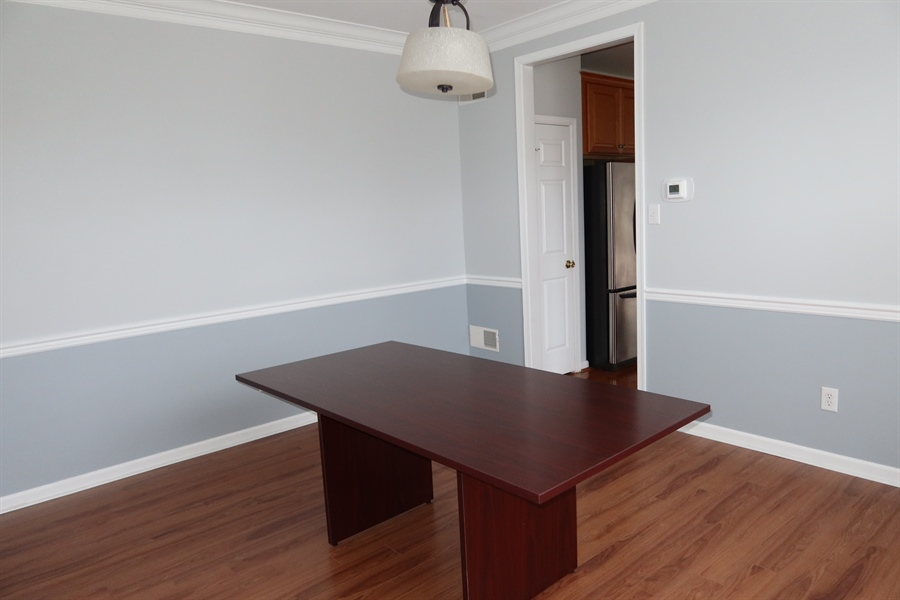 Real Estate Photography - 90 Mccormick Way, Lincoln Univeristy, DE, 19352-9052 - Dining Room has Crown Molding and Chair Rail
