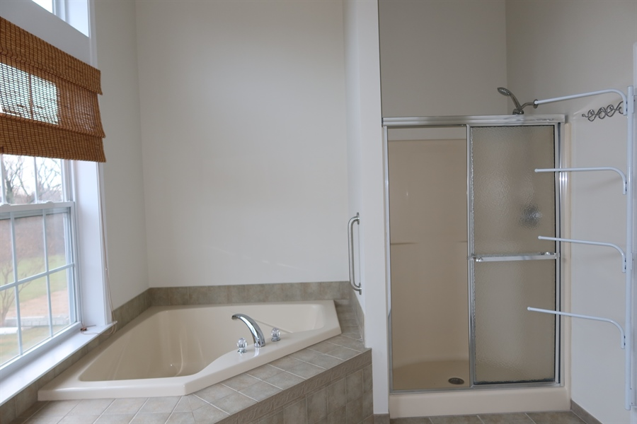 Real Estate Photography - 90 Mccormick Way, Lincoln Univeristy, DE, 19352-9052 - The Private Bath has Tub, Shower, and Double Sinks