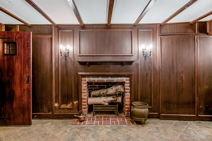 Real Estate Photography - 2000 Woodlawn Ave, Wilmington, DE, 19806 - Lower Level Fireplace