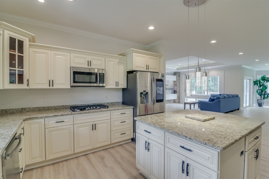 Real Estate Photography - 26180 Tuscany Dr, Millsboro, DE, 19966 - Kitchen Opens to the Great Room/Dinig Room Area