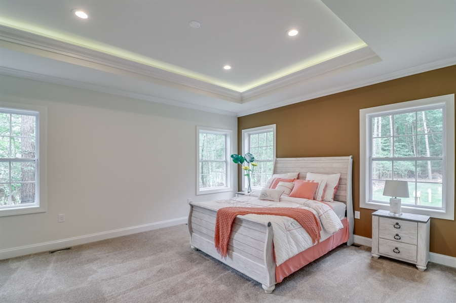 Real Estate Photography - 26180 Tuscany Dr, Millsboro, DE, 19966 - Tray Ceiling & LED Lights in the Master Bedroom