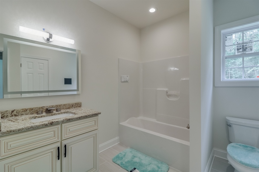 Real Estate Photography - 26180 Tuscany Dr, Millsboro, DE, 19966 - Full Bathroom on Main Level