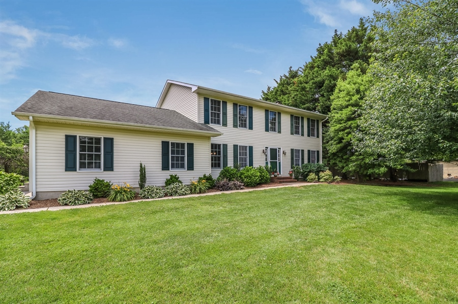 Real Estate Photography - 406 Meadow Ln, Middletown, DE, 19709 - Beautifully landscaped at the front. . . .