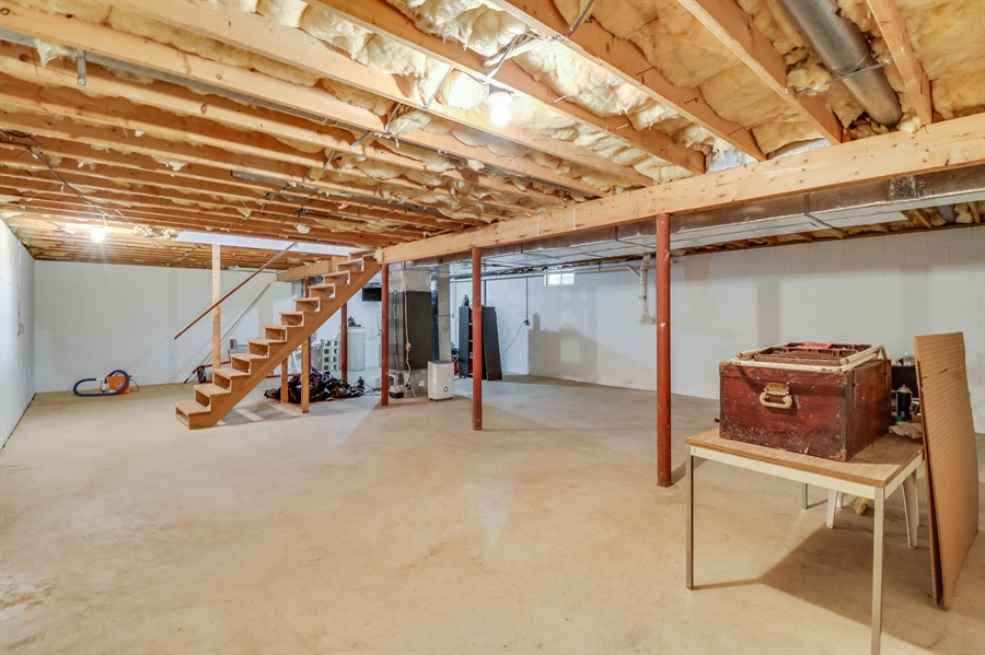 Real Estate Photography - 406 Meadow Ln, Middletown, DE, 19709 - Basement with keyed exit to bilco doors
