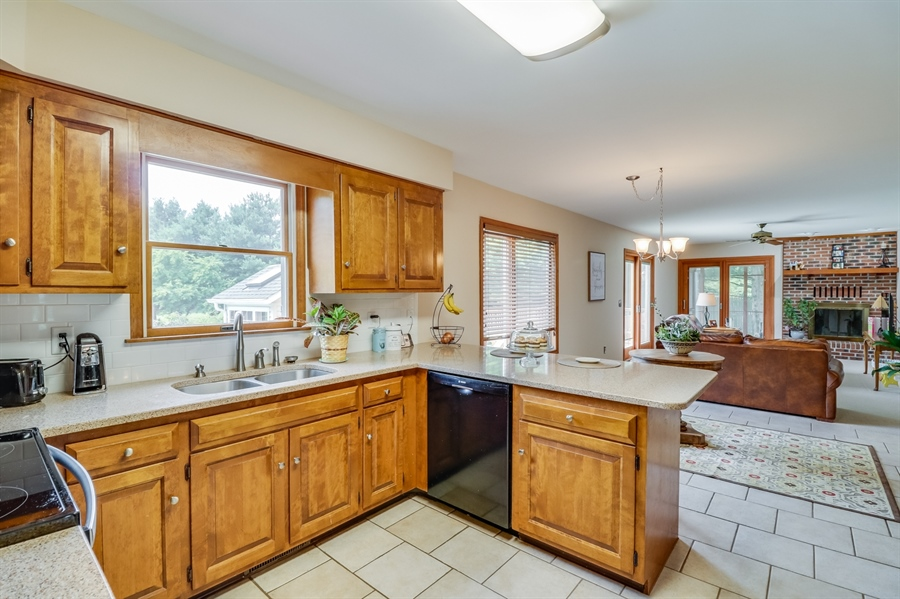 Real Estate Photography - 406 Meadow Ln, Middletown, DE, 19709 - Cherry cabinets, quartz countertop and subway tile