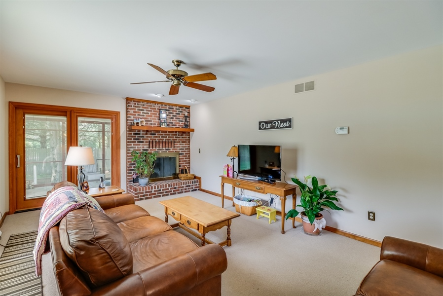 Real Estate Photography - 406 Meadow Ln, Middletown, DE, 19709 - Floor to ceiling brick fireplace in family room