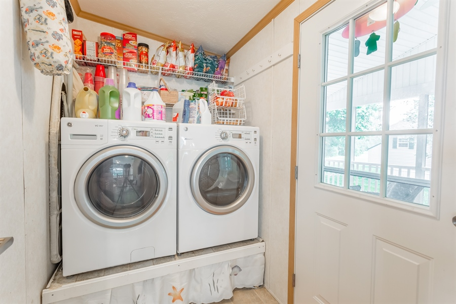 Real Estate Photography - 33034 Suburban Blvd, Lewes, DE, 19958 - Laundry Room