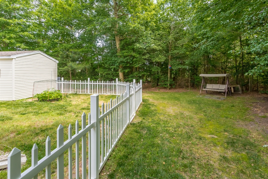 Real Estate Photography - 33034 Suburban Blvd, Lewes, DE, 19958 - Rear Yard Backs to Wooded Lot