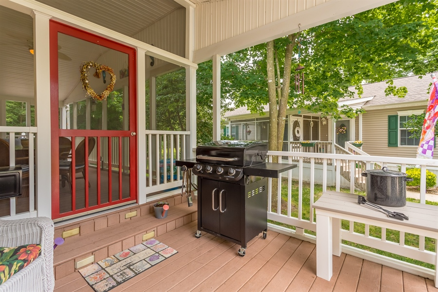 Real Estate Photography - 33034 Suburban Blvd, Lewes, DE, 19958 - Right Side Covered Deck