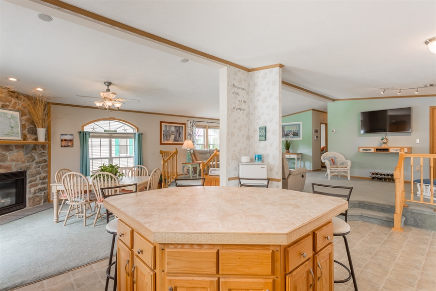 Real Estate Photography - 33034 Suburban Blvd, Lewes, DE, 19958 - Kitchen, Dining Area, Living Room