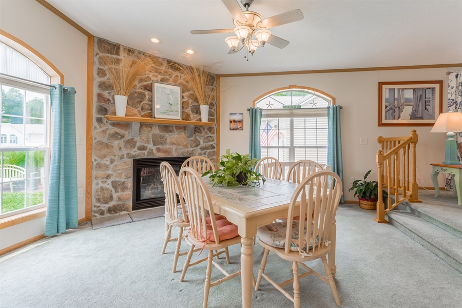 Real Estate Photography - 33034 Suburban Blvd, Lewes, DE, 19958 - Dining Area with Gas Fireplace