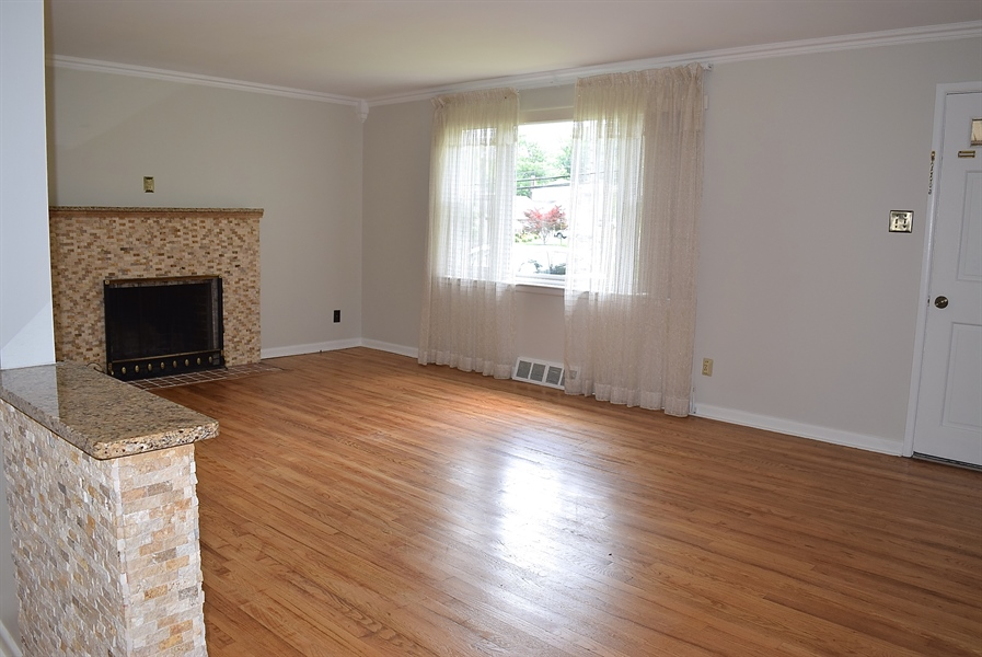 Real Estate Photography - 2907 Duncan Rd, Wilmington, DE, 19808 - Large Living Room with fire place