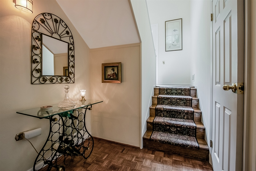 Real Estate Photography - 2 Walnut Ridge Rd, Greenville, DE, 19807 - Alcove with Powder Room and Turned Staircase