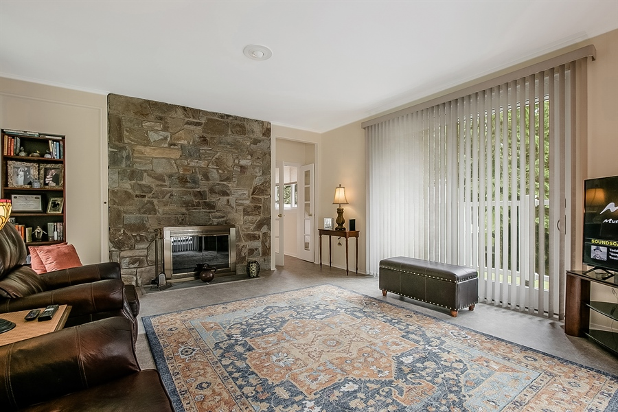 Real Estate Photography - 2 Walnut Ridge Rd, Greenville, DE, 19807 - Family Room with Floor to Ceiling Stone Fireplace