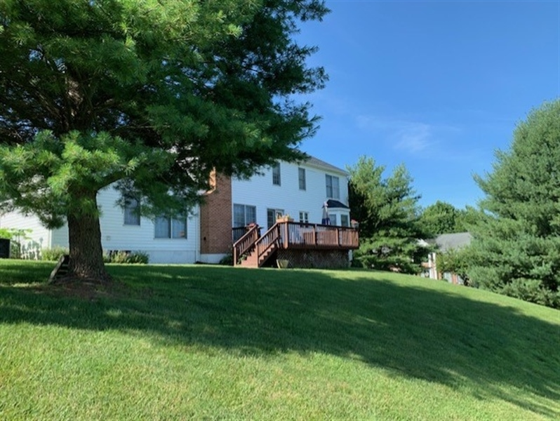 Real Estate Photography - 2 Vireo Cir, Newark, DE, 19711 - Lot does have a slope but house has great views...